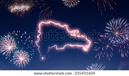 A dark night sky with a sparkling red firecracker in the shape of Dominican Republic composed into.(series) - stock photo