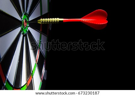 A dart hits the center