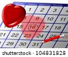 a date marked on a calendar with a big red heart above it / date - stock photo