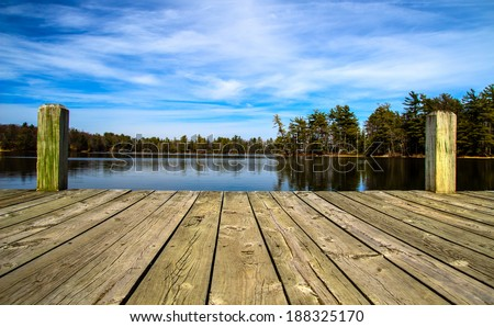A Day At The Lake. Wooden dock overlooking a gorgeous lake in the wilderness.  Ludington State Park. Ludington, Michigan.   - stock photo