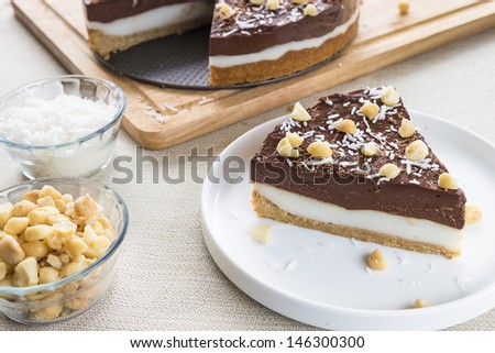 A decadent haupia and chocolate custard pie topped with shaved coconut, macadamia nuts and shaved chocolate - stock photo