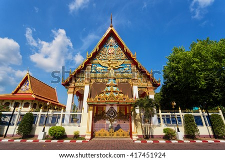 A decorated Mongkol Nimit buddhist temple located in old Phuket town in Phuket - stock photo