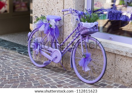 a decorative, purple bike