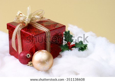 A decorative setting of the seasonal Christmas theme a nice red gift box.