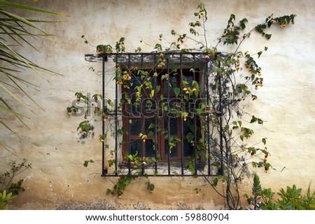 A Decorative Window in Carmel Mission - stock photo