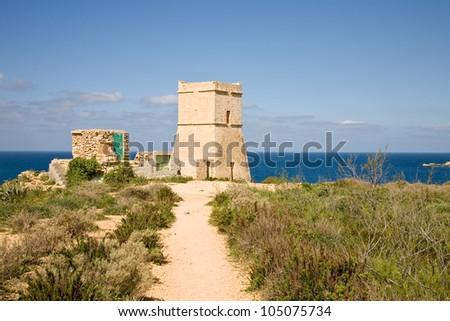 A defense tower next to the Ghajn Tuffieha Bay in Malta - stock photo