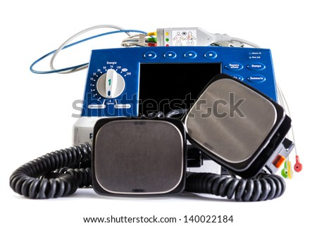 a defibrillator unit isolated over a white background - stock photo