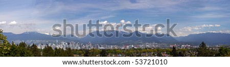 A 270 degree panorama view of Vancouver downtown with mountain background. - stock photo
