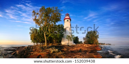 A 180 Degree Panoramic View At The Marblehead Lighthouse In Early Morning Light On Lake Erie, Marblehead Ohio, USA - stock photo