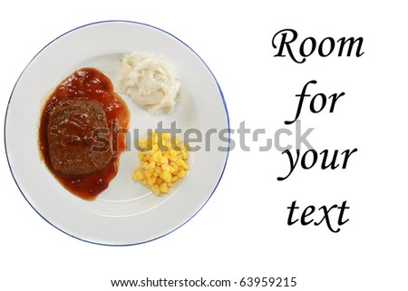 a delicious and nutritious classic Salisbury steak tv dinner with mashed potatoes and corn in its black plastic tray, isolated on white - stock photo