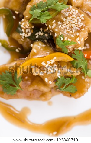 A delicious Chinese meal of Sweet and Sour Fish in sauce with vegetables