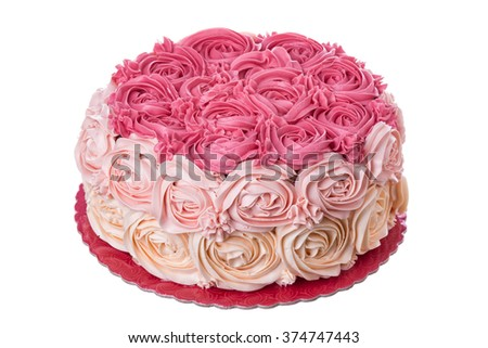 A delicious cream cake with roses. Close-up.