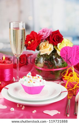 A delicious creamy dessert on celebratory table of Valentine's Day on room background - stock photo