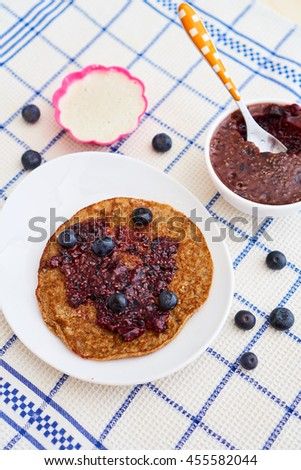 A delicious desert with healthy pancakes, homemade ice cream and blueberry jam  - stock photo