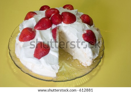 A delicious dessert made almost entirely from egg white, covered with whipped cream and fresh strawberries - stock photo