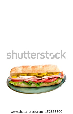 A delicious Italian sub sandwich isolated on a white vertical background with plenty of space for text. - stock photo