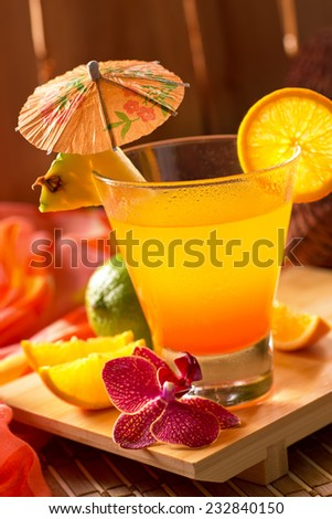 A delicious mai tai cocktail in a tropical tiki hut setting. - stock photo