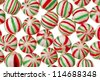 A delicious red and green peppermint candy on a white background - stock photo