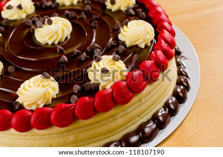 A Delicious Red Velvet Cake with Chocolate Frosting and Vanilla Swirls - stock photo