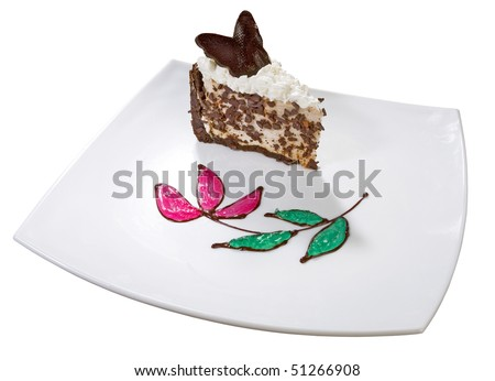 A delicious souffle cake served on plate,  topped with whipping cream and chocolate, decorated chocolate crumbs, mint and cherry jelly. Isolated on white. - stock photo