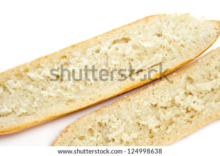 a demi-baguette cut in half on a white background - stock photo