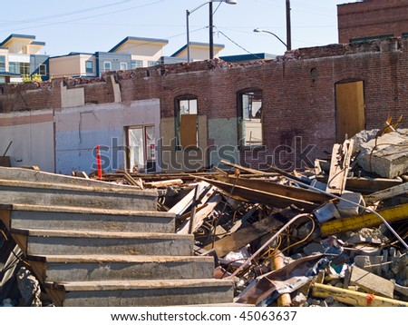 A demolition site with a pile of demolished brick wall and concrete debris - stock photo