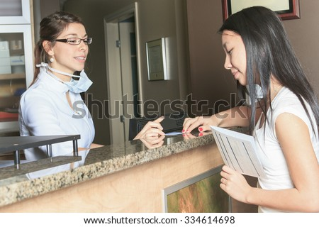 A dental assistance receptionist appointment at the dentist office - stock photo