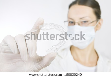 a dentist with tooth tray (hands holding individual tooth tray) - stock photo