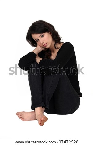 A depressed woman - stock photo