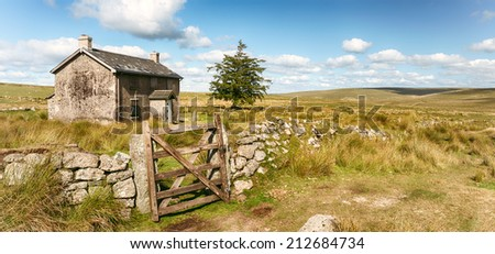 A derelict and abandoned farmhouse at Nun's Cross a remote part of Dartmoor National Park near Princetown in Devon - stock photo