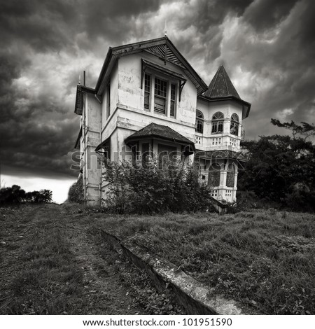 A derelict old house on top of a hill - stock photo