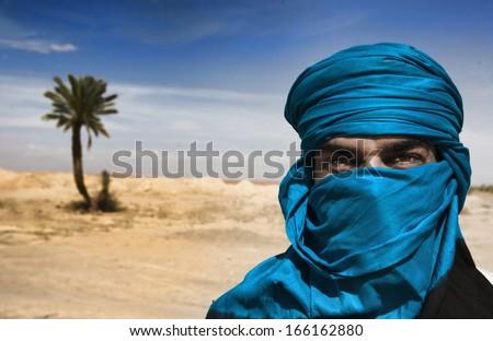A desert explorar covered with turban - stock photo