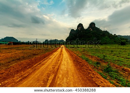 A deserted red dirt road to strange cliffs in Vietnam