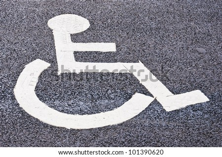 A designated parking spot found in all of the worlds cities that's restricted to all but disabled drivers that have a disability of some sort. - stock photo