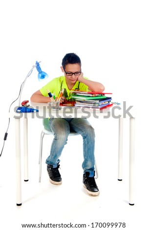 a desk for a teenager to make homework. Desk with books, exercise books, lamp; pen, pencils and a chair. - stock photo