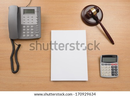 A desk of a judge or lawyer or solicitor with a blank document for copy space