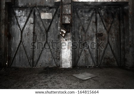 a desolate old industrial building inside, two door - stock photo