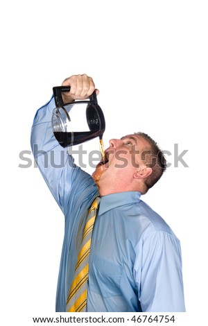 A desperate businessman drinks a pot of hot coffee to wake up because he is addicted to caffeine.