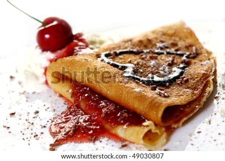 a dessert plate with pancakes and strawberry - stock photo
