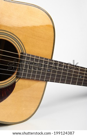 a detail of an acoustic guitar  in white background