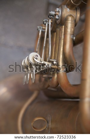A detail of an old wind instrument