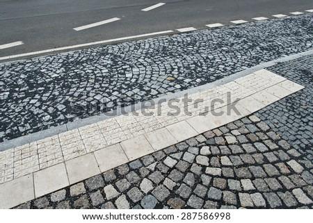 a detail of old granite sidewalk - stock photo
