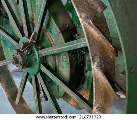 a detail of old rusty tractor wheel