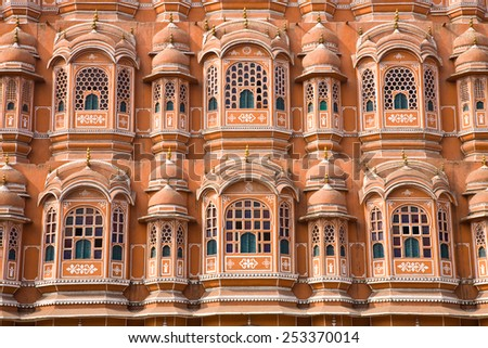 A detail of the facade of the pink Hawa Mahal as seen from the road in the city of Jaipur in eastern Rajasthan, India - stock photo