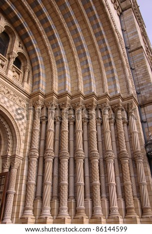 A detail of the grand entrance of the historic waterhouse building with the basalt columns in Kensington in London  accommodating the natural history museum - stock photo