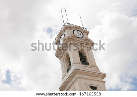 A detail of the tower of the university of Coimbra. - stock photo