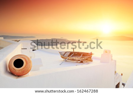 A detail of traditional house at Santorini island, Greece on sunset - stock photo