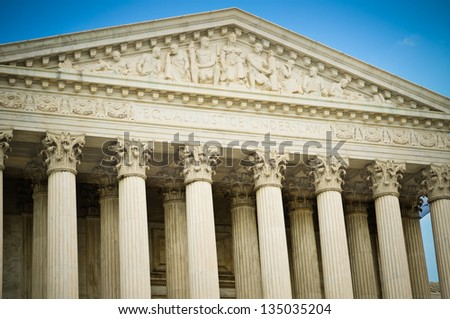 "A detail shot of the US Supreme Court building highlighting the inscription ""Equal Justice Under Law""."