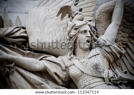 A detail statue breaks free from a side of the Arc de Triumph - stock photo