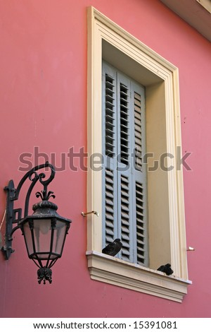 A detail (window and lamp) of an old house in the old area of Plaka, in Athens, Greece
